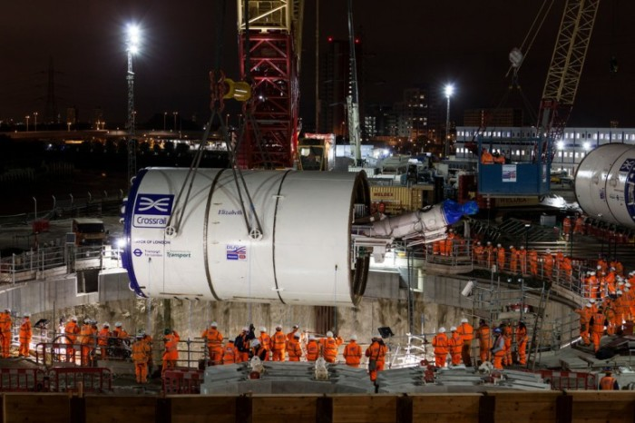 Crossrail construction site: the Tunnel Boring Machine is lowered into the shaft.